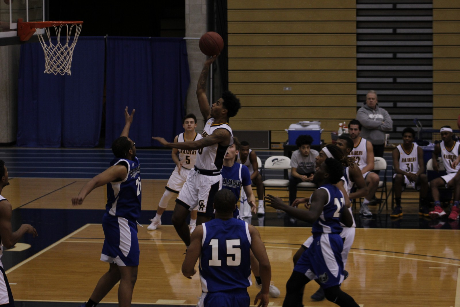 Sophomore Guard, #3, Jeffrey Drake-Todd shoots the floater for two points against Kellogg CC.