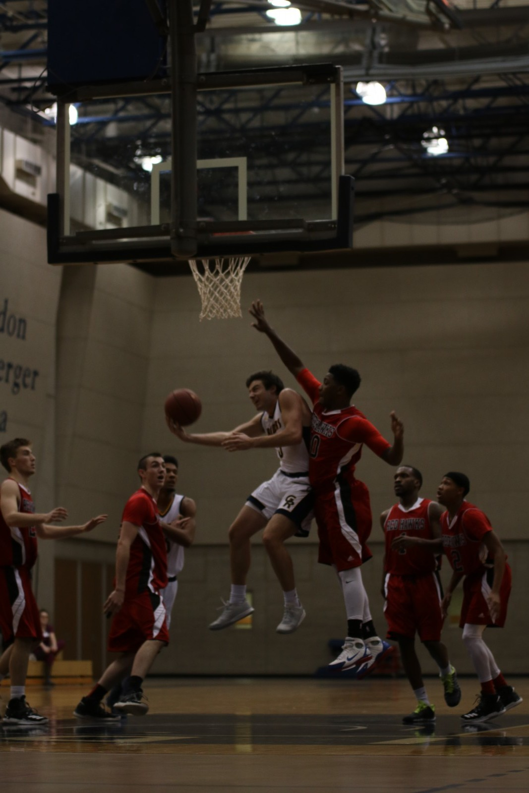 Freshman Guard, #5, Zach Pangborn going up for a contested layup against Lake Michigan College.