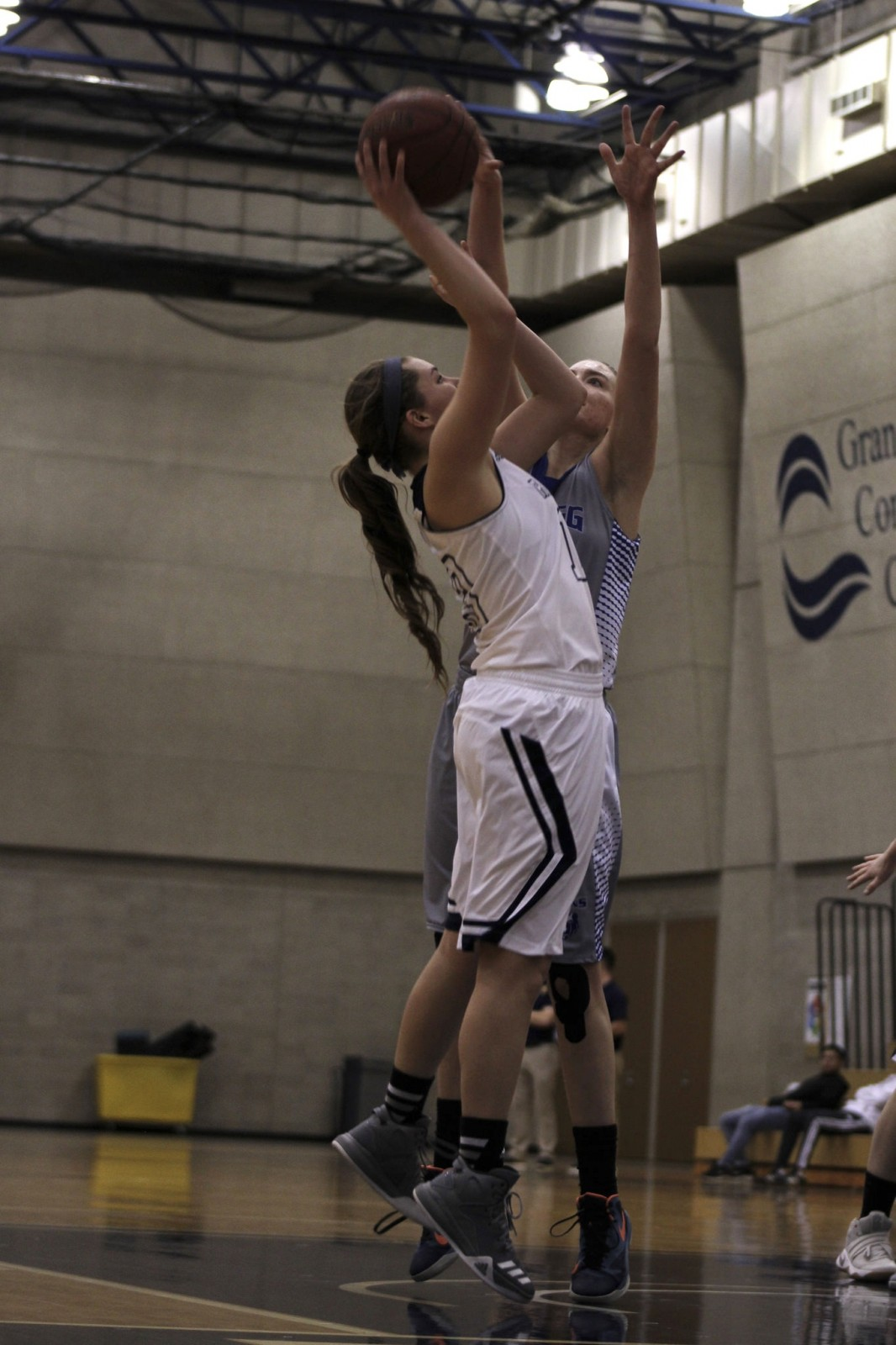 Freshman Guard, #13, Josie Manion going up for the contested layup.