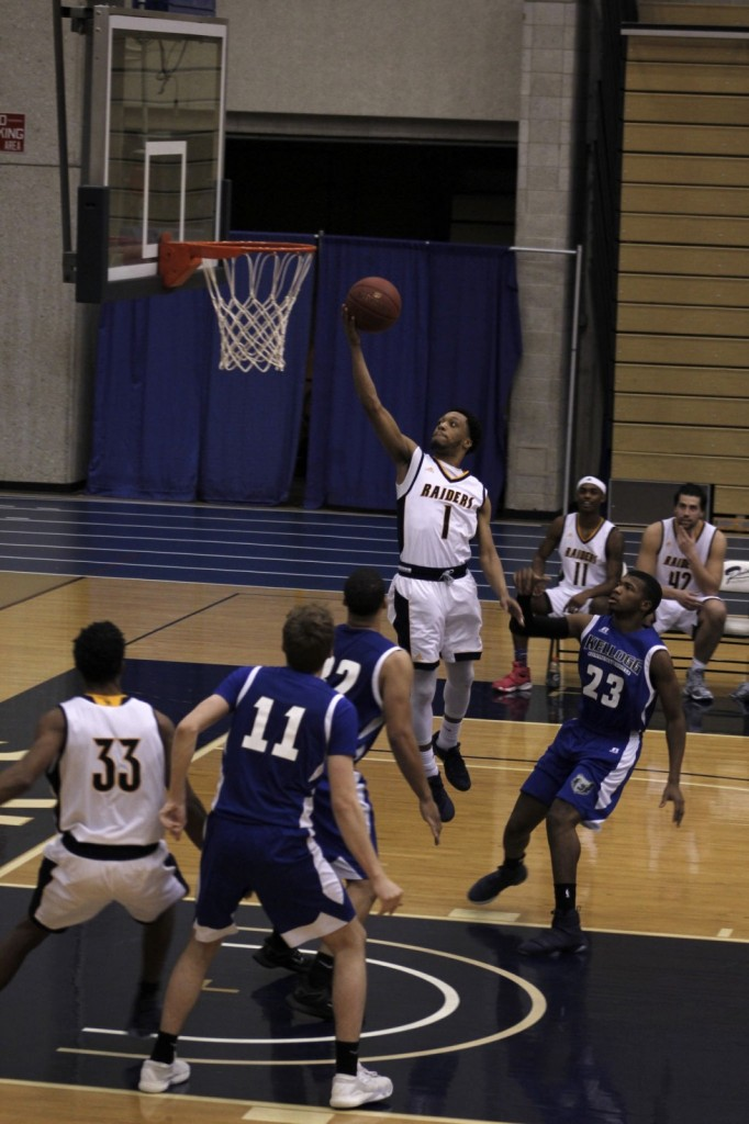 Sophomore Guard, #1, Arthur Pearson drives to the lane and scores an easy lay up for GRCC.