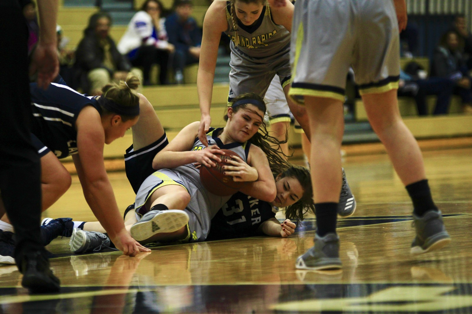 Freshman Guard, #13, Josie Manion dives and fights for the loose ball.