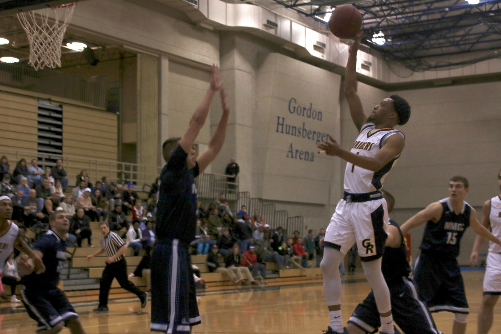 Sophomore Guard, #1, Arthur Pearson shoots the tear drop against Mid Michigan CC.