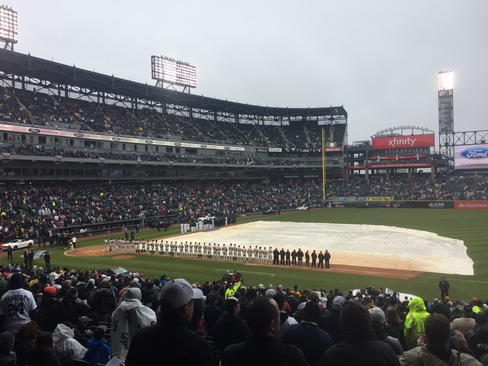 The White Sox did the opening ceremony amidst rain, with the tarp remaining on the field. The game was later cancelled.