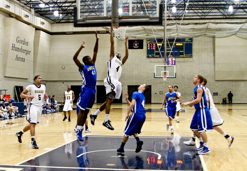 Daryl White shoots a basket for the Raiders.