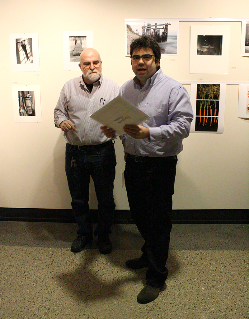 Filippo Tagliati (right) and Jonathon Russell (left) announce winners of the Photo Student Exhibit People's Choice Awards.
