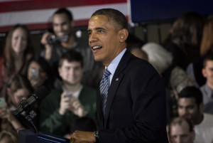 Obama starts off his visit with high praise to Tim Izzo and the Michigan State Spartans basketball team.