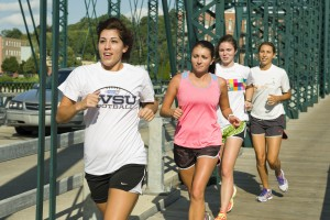 Members of the girls cross country team practice in preparation for their first season.  Photo by Jonathan D. Lopez – Photo Editor.
