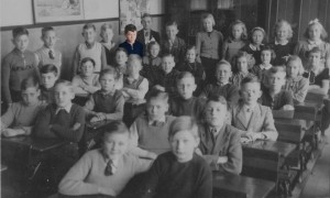 Lauren Winther's Opa (grandfather), in color, as an orphan posing with his classmates at St. Jozef in 1944.