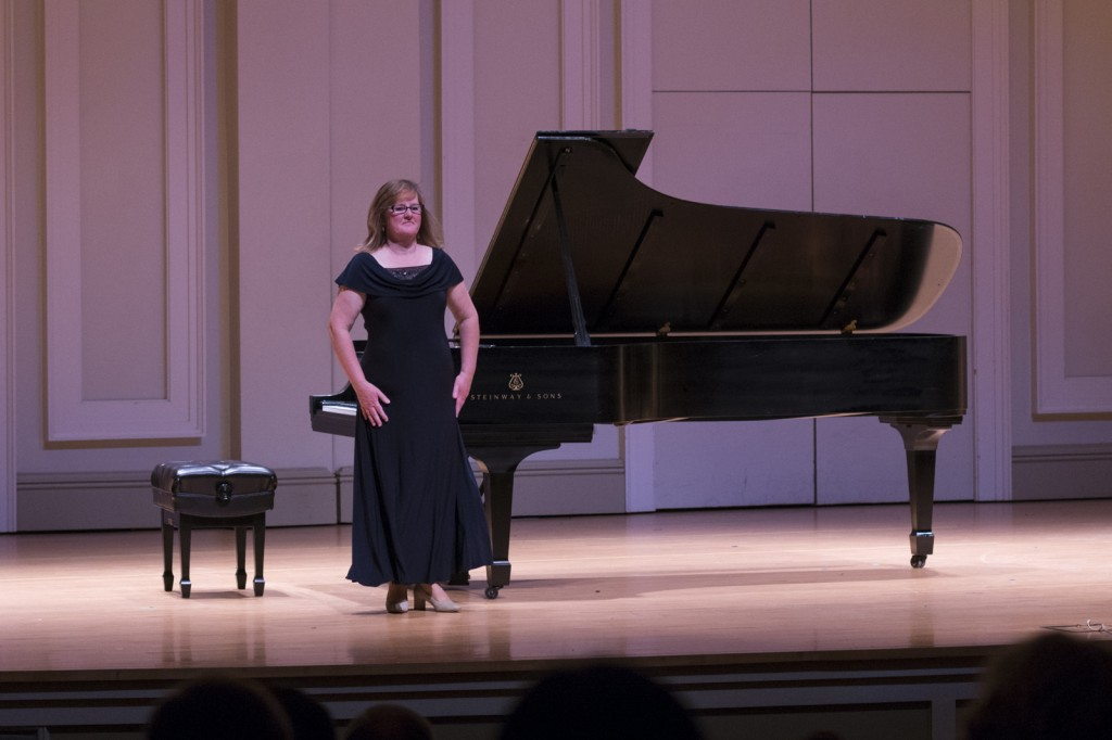 Debora DeWitt, pianist, stands after playing Prelude and Fugue III. Photo by Jonathan D. Lopez