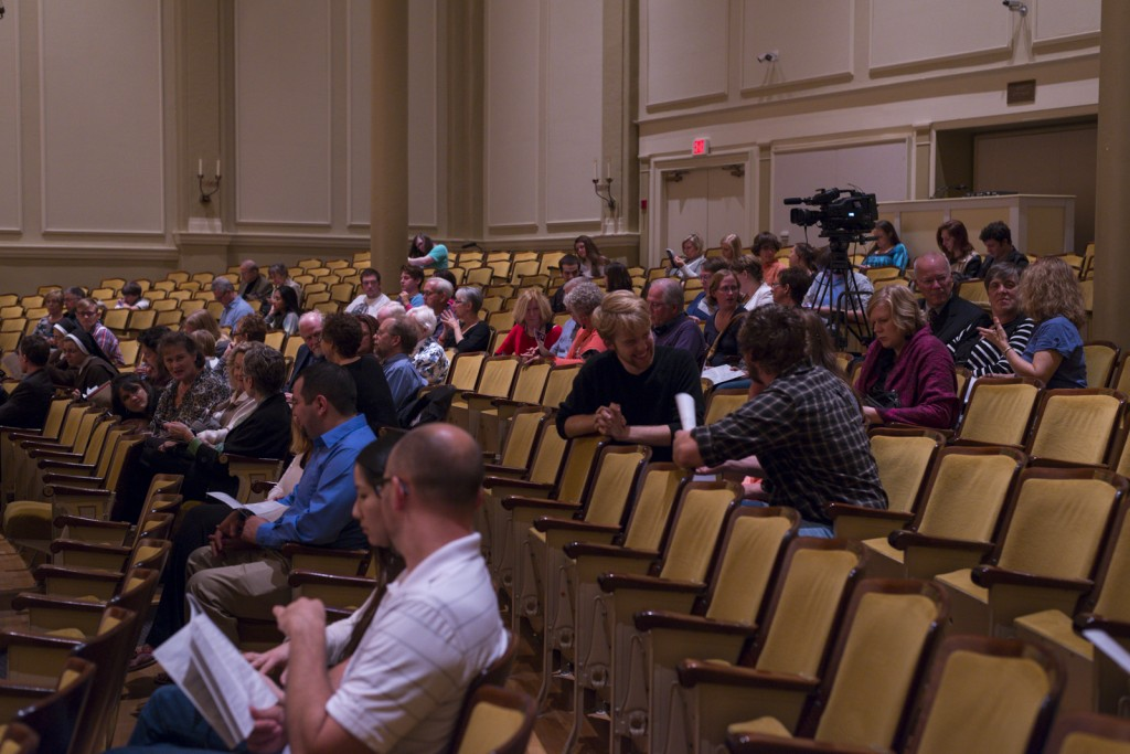 People started flowing into the auditorium at 7 p.m. Photo by Jonathan D. Lopez