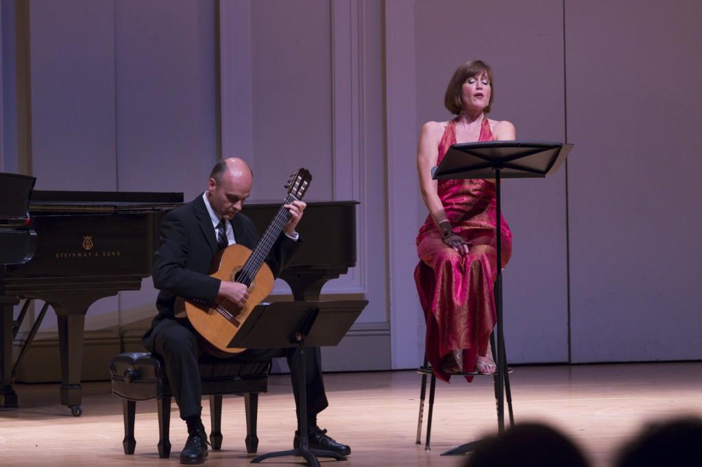 Brian Morris played the guitar as Diane Penning sang Bachianas Brasileiras No. 5. Photo by Jonathan D. Lopez