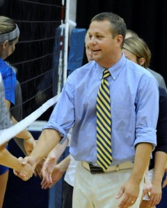 GRCC Volleyball Coach Chip Will shakes opponents' hands after a match against Lansing CC last year.
