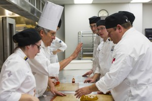 Chef Renusson and students watch a demonstration to make a sugar pull in fall of 2014. Photo by Jonathan D. Lopez
