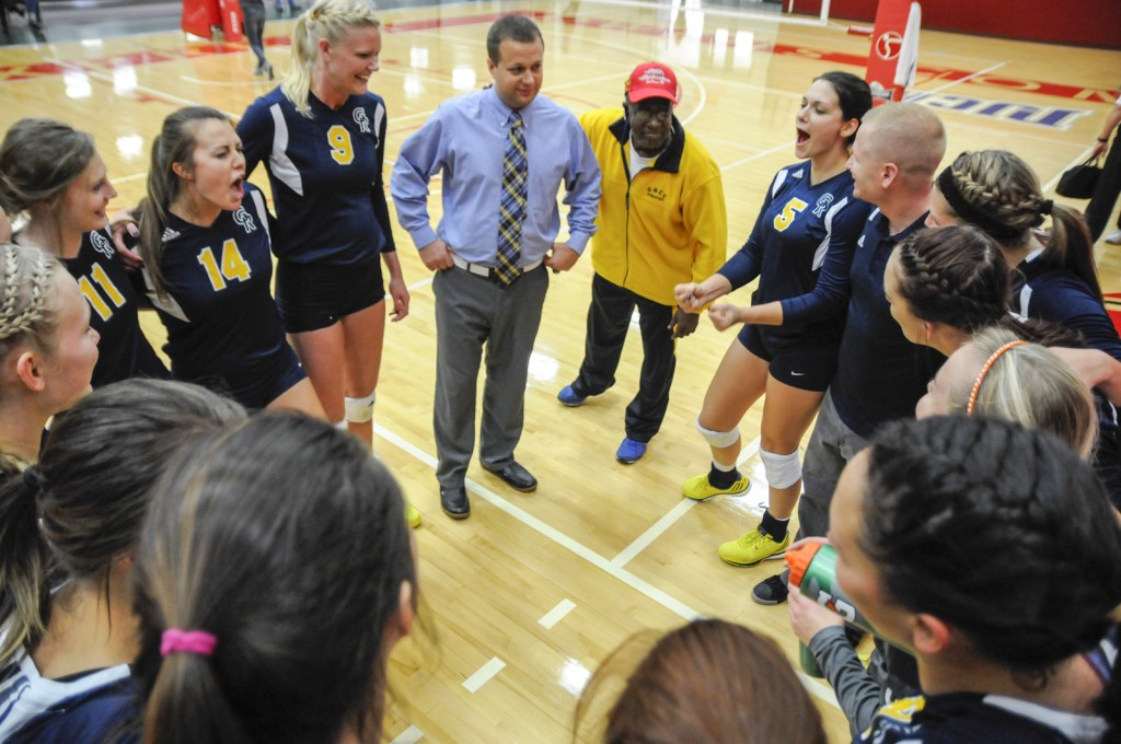 GRCC Athletic Director Charlie Wells (in Yellow) addresses the team, letting them know how proud he is of them. Photo by John Rothwell