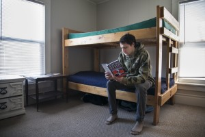Jones reading in his bedroom at Touchstone, a recovery house.
