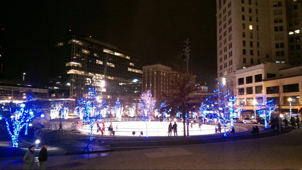 Ice skaters fill Rosa Parks Circle on a winter night.  Photo by Kayla Tucker