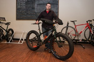 Nathan Falls, 32, of Grand Rapids, next to his Kona Wo fat bike.