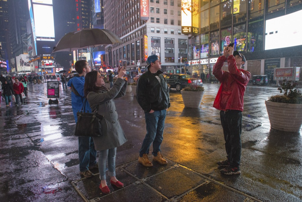 Collegiate staffers made no attempt to hide the fact that they are tourists on their first night in Times Square.  Photo by Jonathan D. Lopez