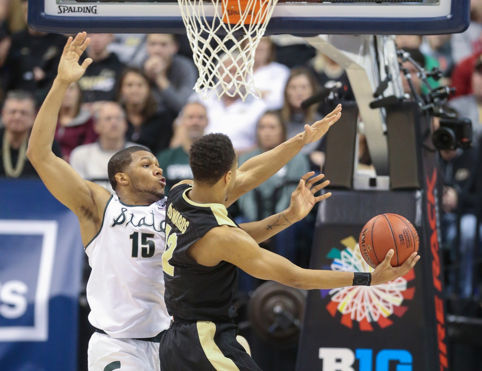 Michigan State's Marvin Clark Jr. defends against Purdue's Vince Edwards during the second half on Sunday, March 13, 2016, at Bankers Life Fieldhouse in Indianapolis.