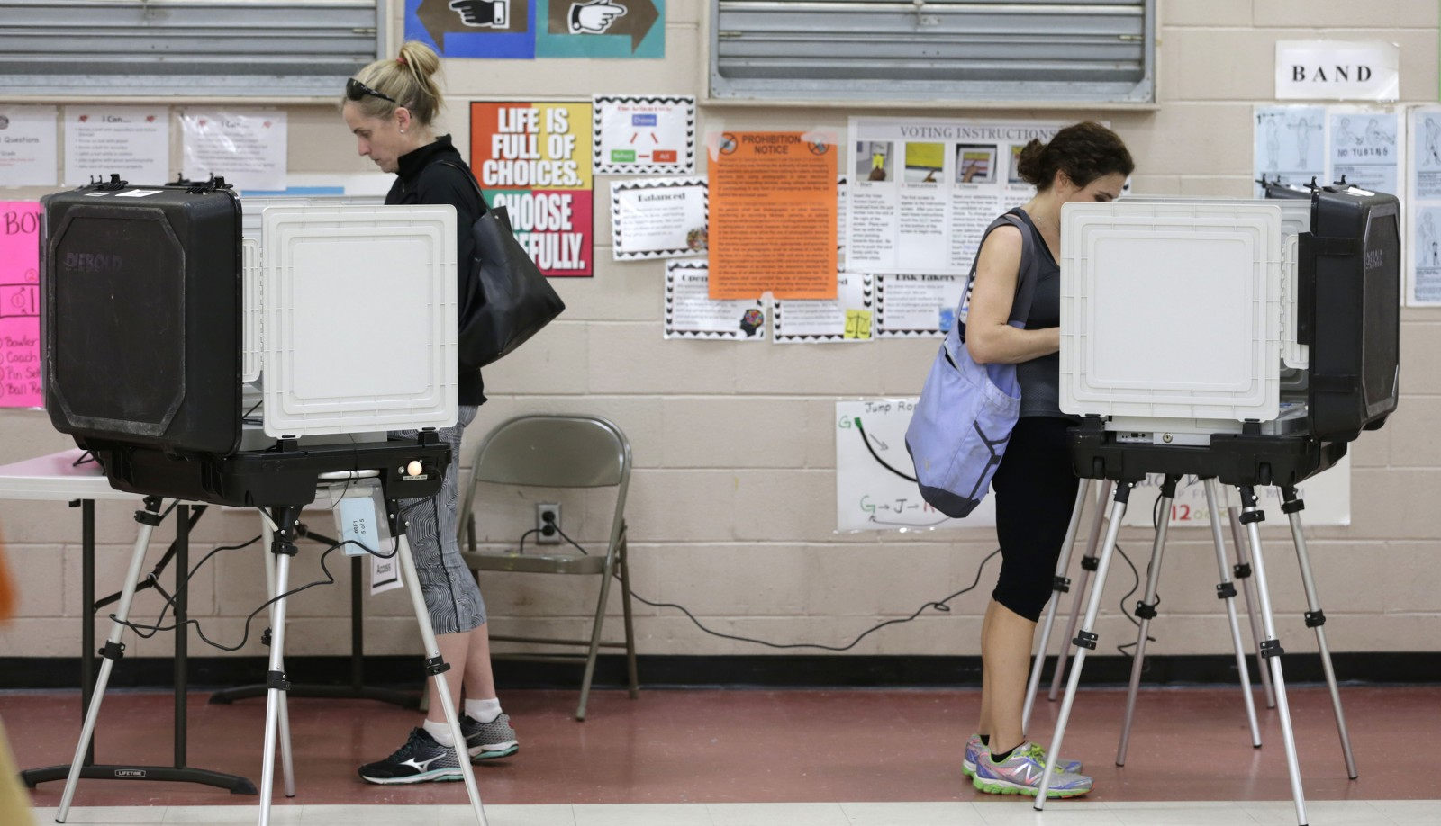 Voters sign in at Morris Brandon Elementary on March 1, 2016 in Atlanta, Ga.