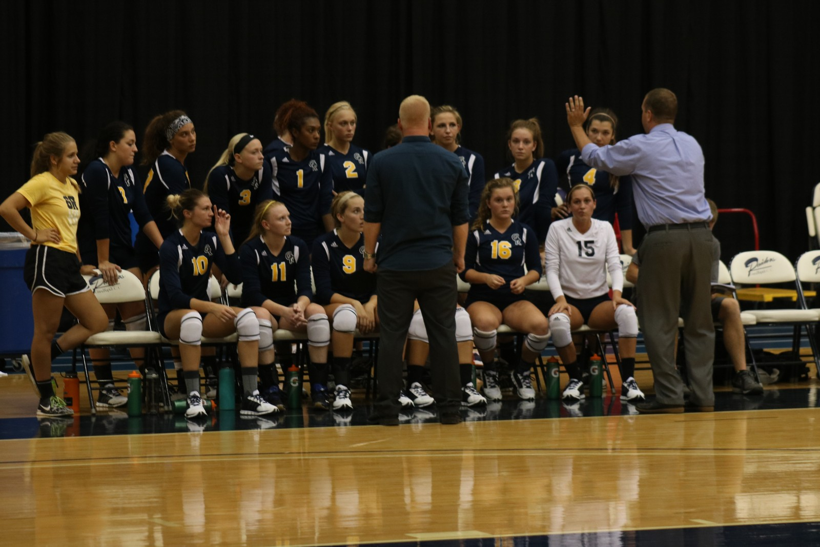 Head Coach Chip Will (right) and Assistant Coach David Rawles (left) talk to the team during a timeout.