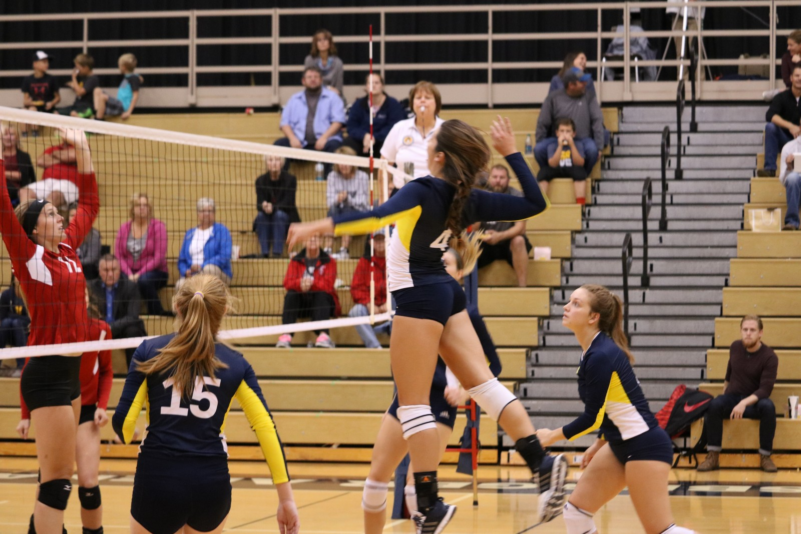 Sophomore Outside Hitter, #4, Lauren Weiber jumping to spike the ball for a kill versus Lake Michigan College on Sept. 27.