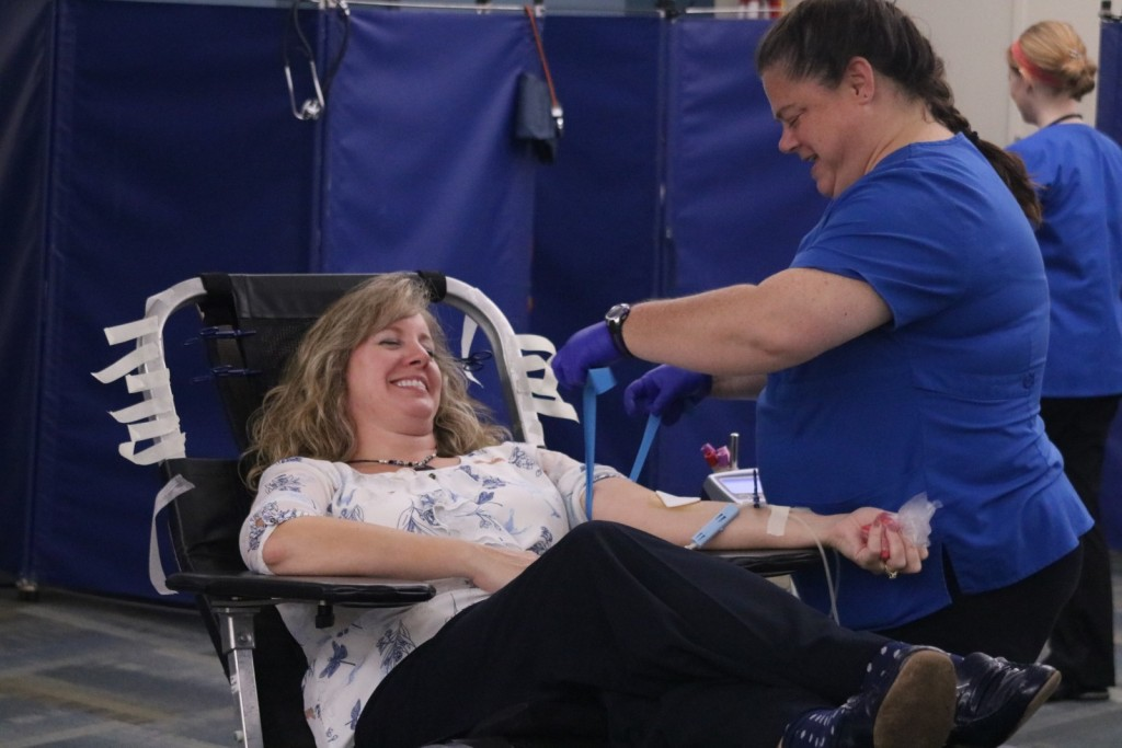 GRCC Police Chief, Rebecca Whitman, donates blood at the Michigan Blood Drive.