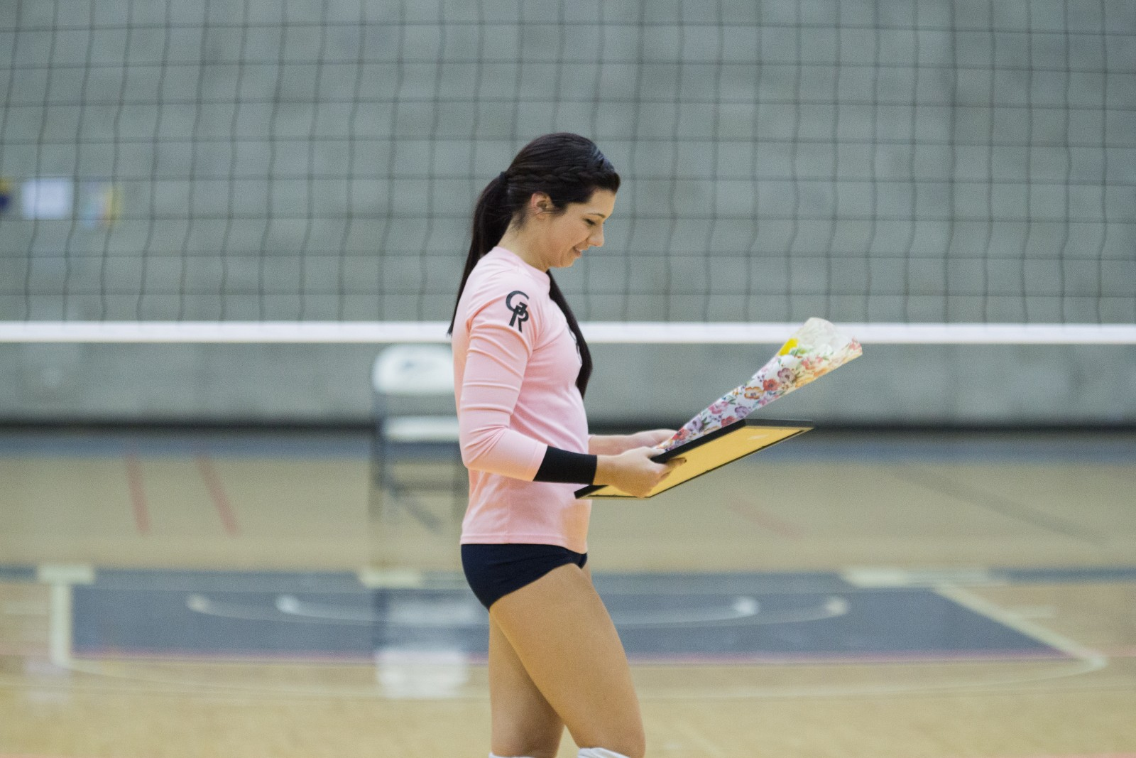 Sophomore Outside Hitter, #4, Lauren Wieber receiving GRCC's honoring of her mother, Shanon Wieber, after she passed away from breast cancer March 7, 2015