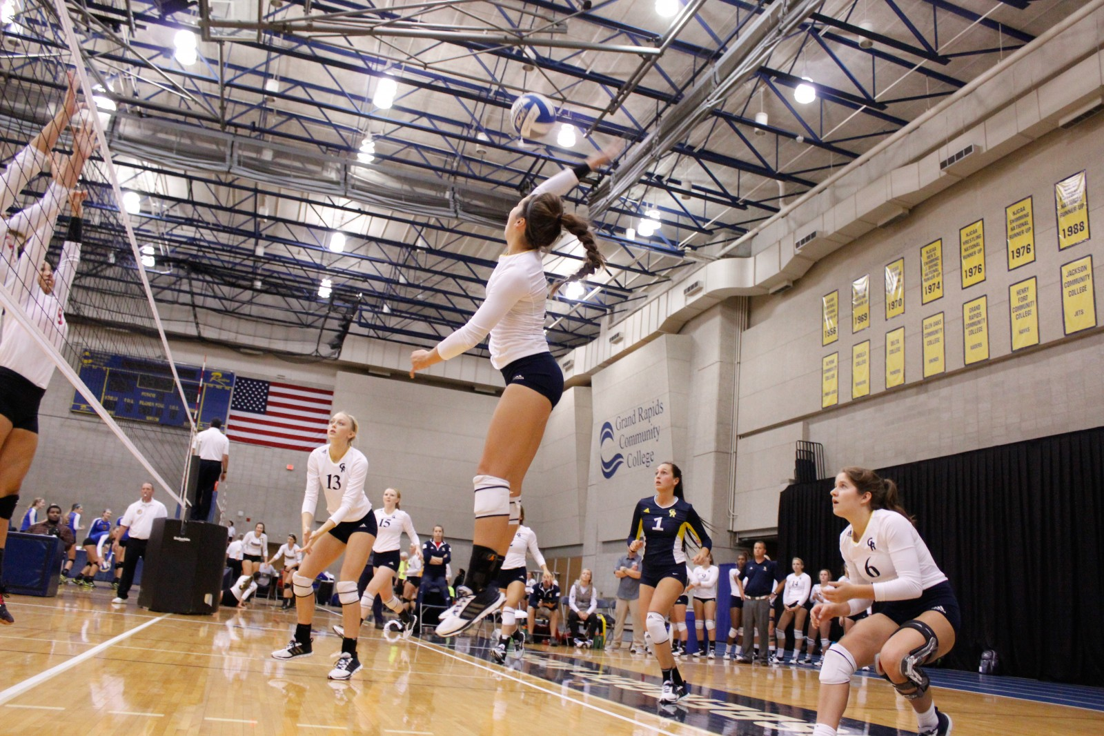 Sophomore Outside Hitter, #4, Lauren Wieber going up to spike the ball for a kill in GRCC's game versus Owens CC (OH) in the Raider Challenge tournament on Oct. 2.