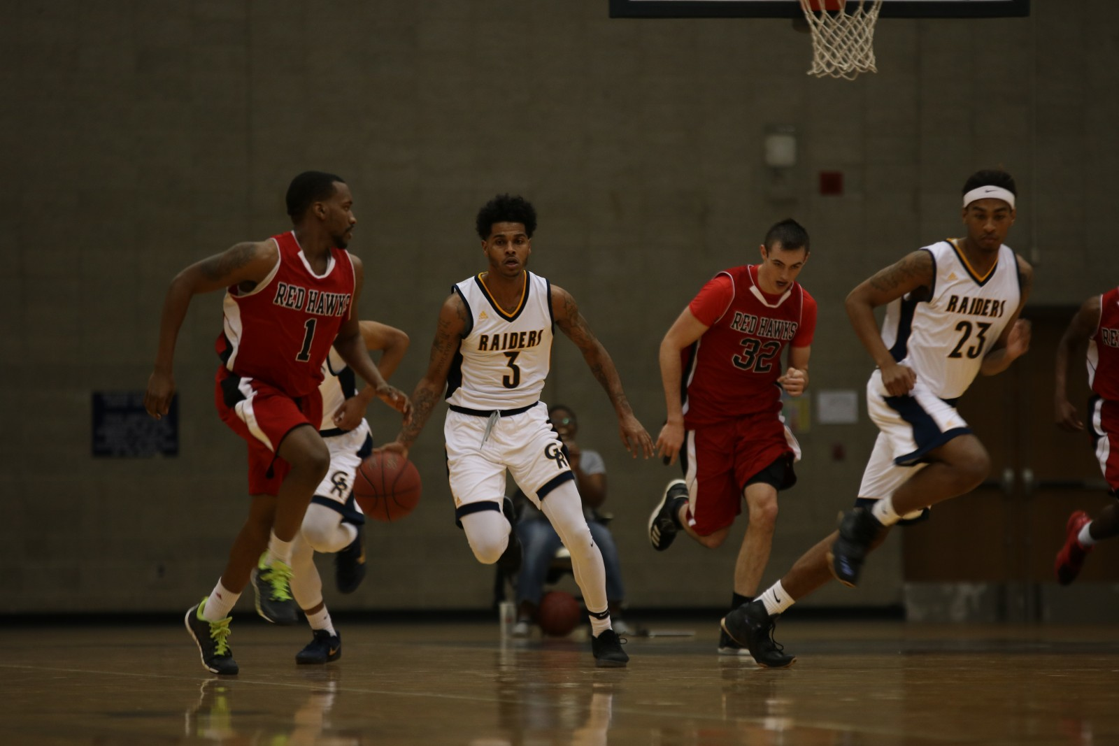 Sophomore Guard, #3, Jeffrey Drake-Todd dribbling through traffic and up the court for GRCC.