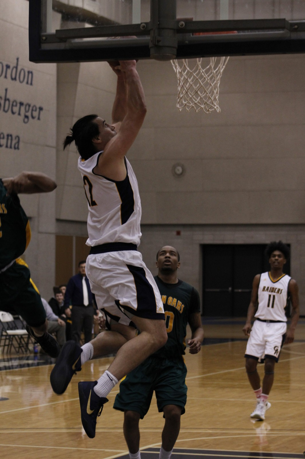 Sophomore Center, #42, Max Prendergast goes up for layup against Glen Oaks CC.