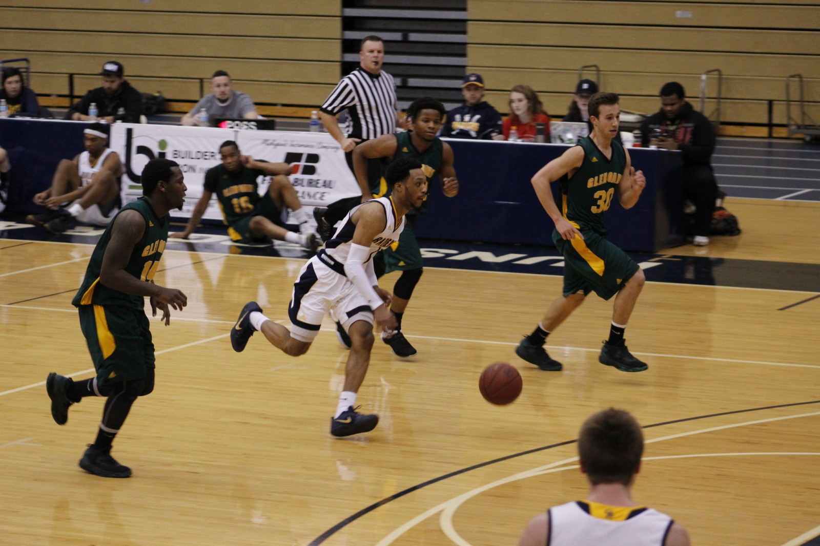 Sophomore Guard, #1, Arthur Pearson dribbling down the court to push the offense for GRCC to score in transition.