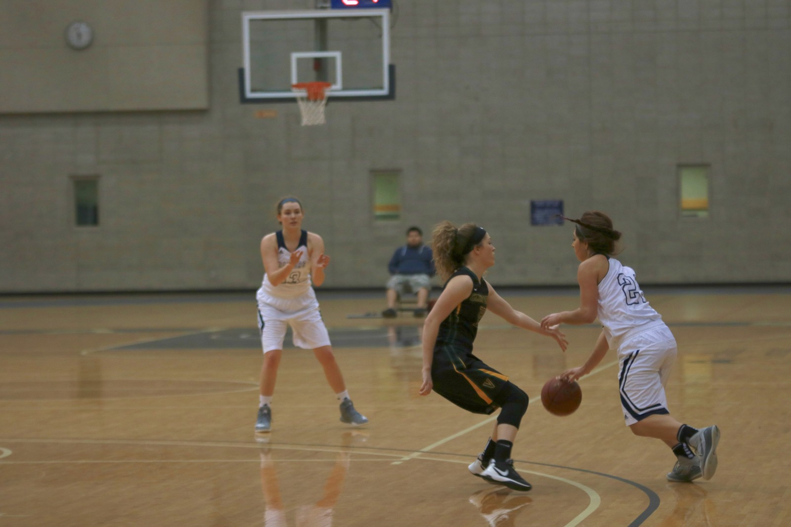 Freshman Guard, #21, Maddie Albert (right) with the ball and driving towards the basket as Freshman Forward, #13, Josie Manion is on the perimeter for the extra pass.