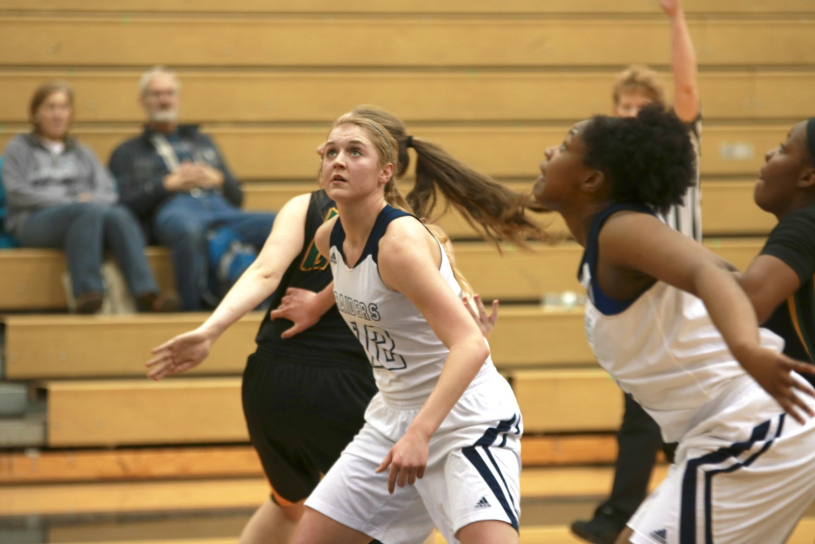 Freshman Center, #12, Makayla Beld (left) and Freshman Forward, #44, Kari Wilson being out glen Oaks for the rebound.