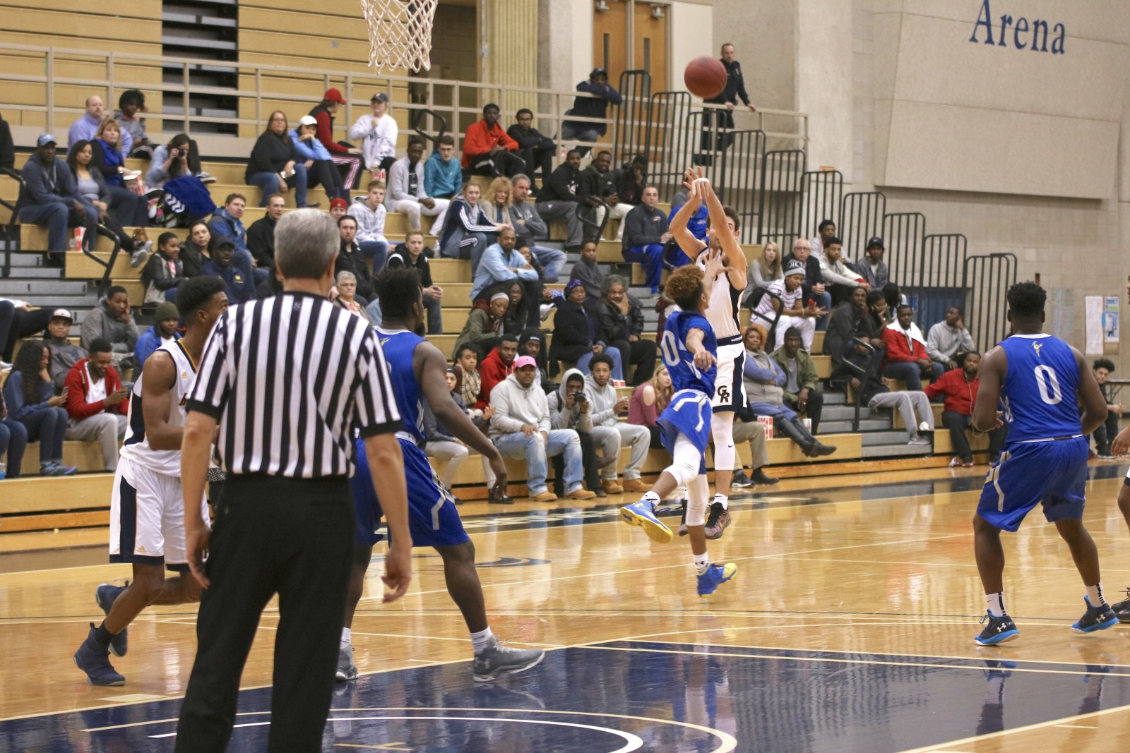 Freshman Guard, #5, Zach Pangborn shoots a 3-pointer against Ancilla College.