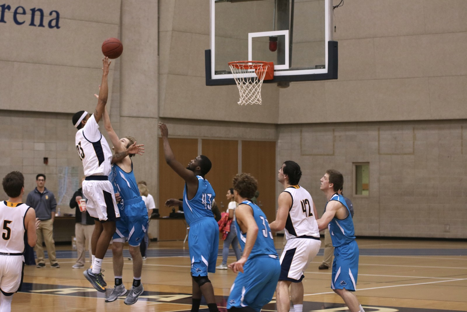 Freshman Forward, #23, Corey Jones pulls up for the floater over KVCC.