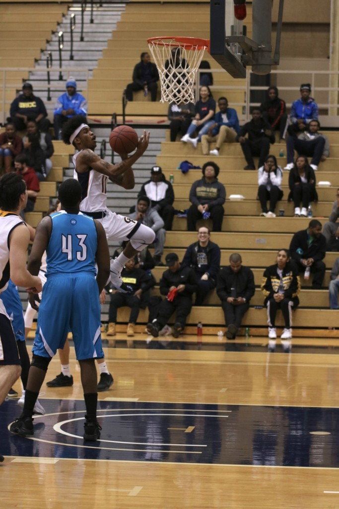Freshman Guard, #11, Darron Ewing Jr. drives to the hoop to score two points for GRCC.