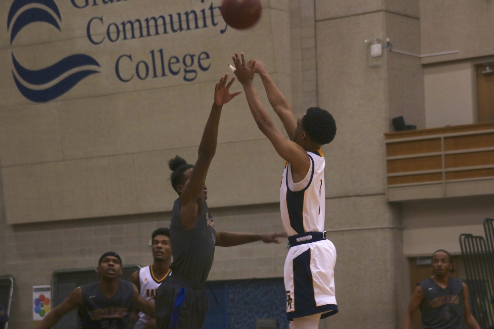 Sophomore Guard, #1, Arthur Pearson pulls up for the jump shot with a Muskegon CC hand in his face.
