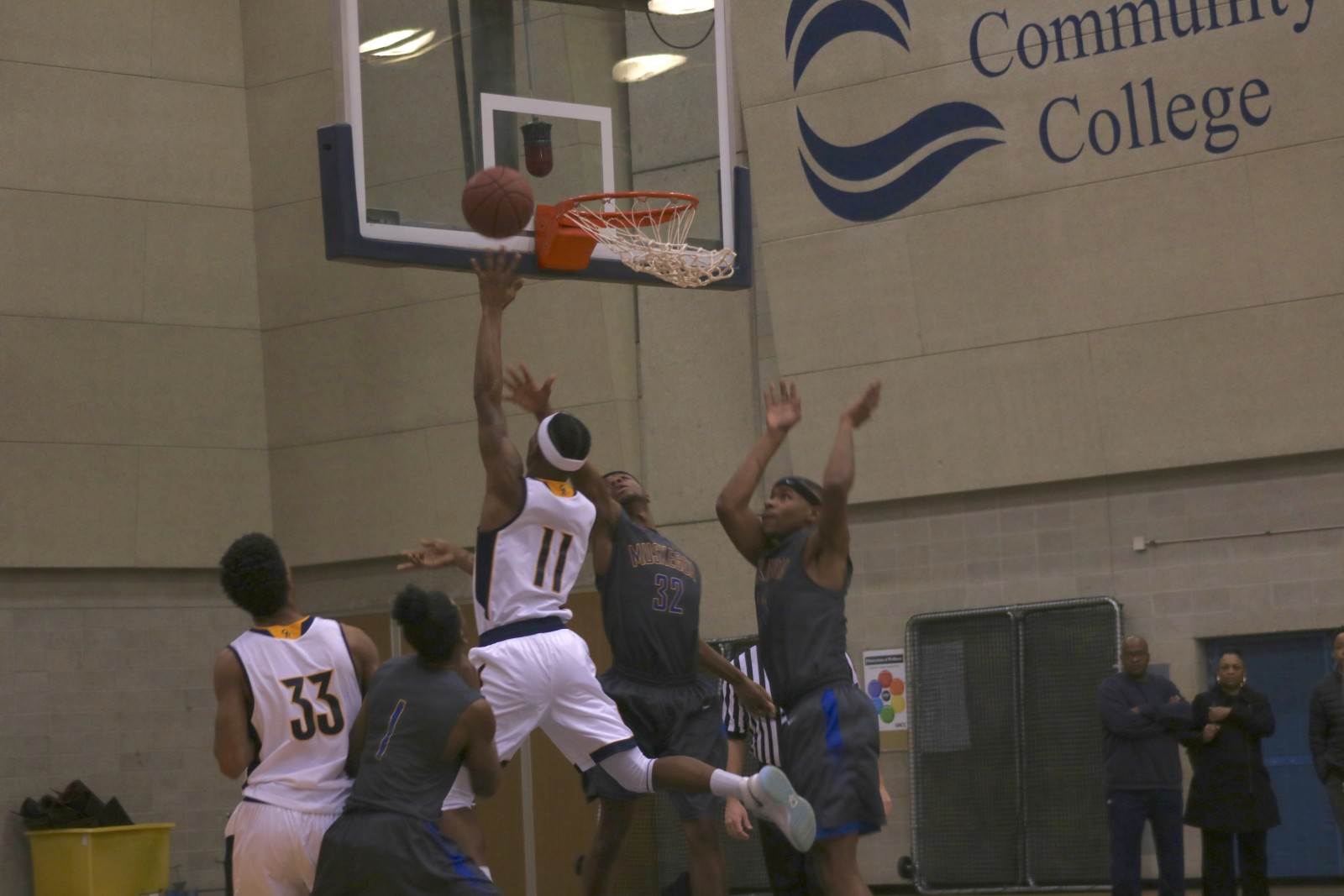 Freshman Guard, #11, Darron Ewing Jr. shoots the contested layup for GRCC.